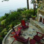 outdoor fireplace on a patio by the water